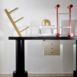 <p><strong><a href=ettore-sottsass.html class=link-lightbox>Ettore Sottsass</a></strong><br />Bharata</p><p><strong>Acropoli</strong><br />Side table in lacquered wood, marble, stainless<br />steel, gilded wood and halogen lamp.<br />200 x 55 x h. 184 cm. </p>
