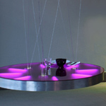 <p><strong><a href=johanna-grawunder.html class=link-lightbox>Johanna Grawunder</a></strong><br />In the Desert</p><p><strong>Puddle</strong><br />Luminous round table  in polished aluminium structure and colored Perspex top. Suspension from  ceiling by adjustable steel cables. Internal lighting system with 8 fluorescent  tubes.<br />  d. 128 cm.</p><p>Limited edition of 6 signed and numbered  pieces.</p>